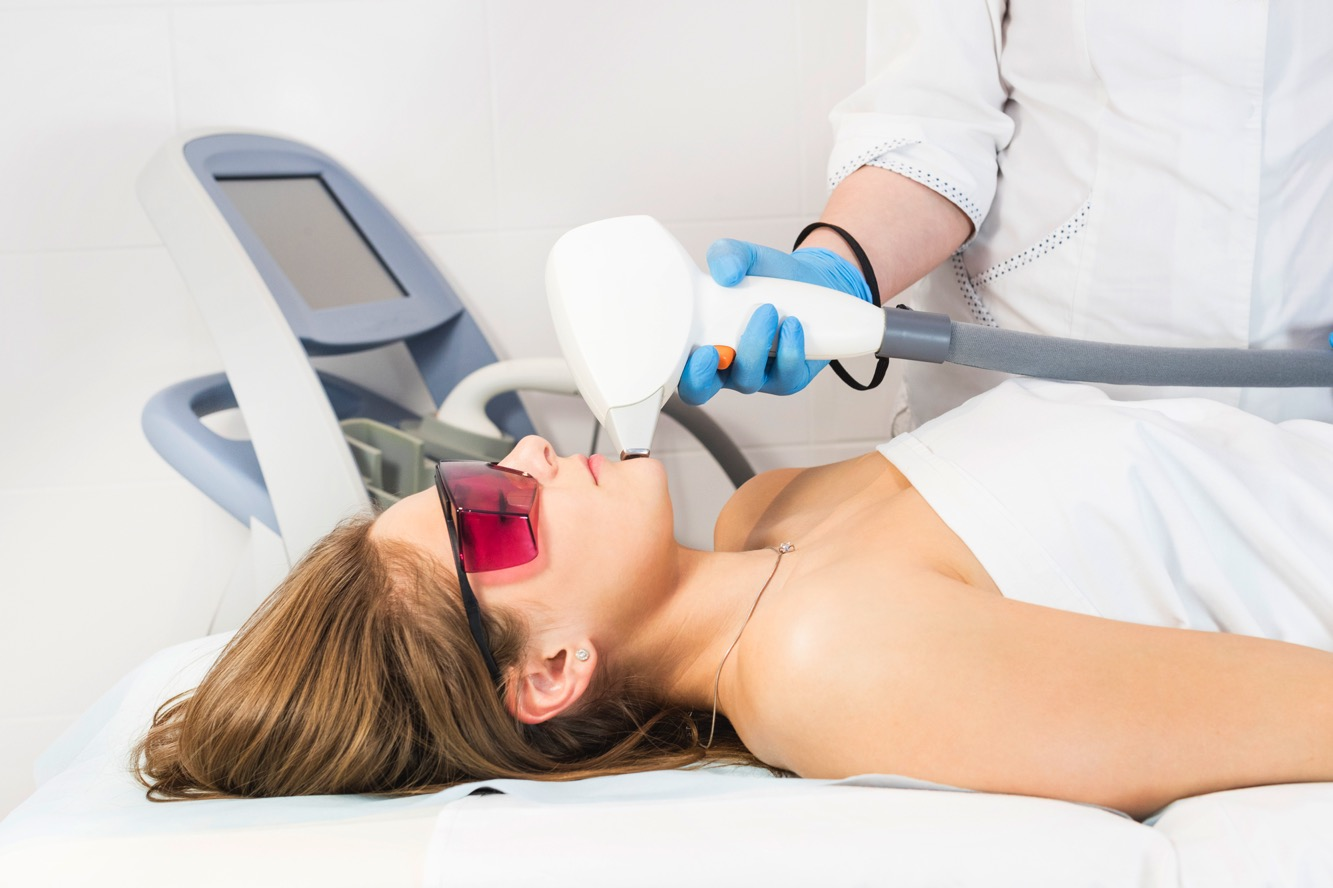 woman giving laser derm procedure